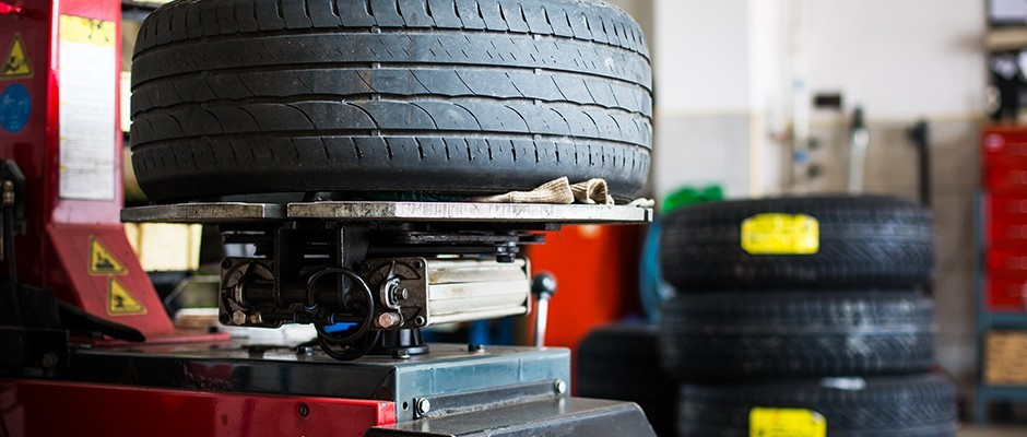 Tire being balanced in auto shop
